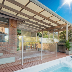 Patio enclosure with netting for sun relief over pool area